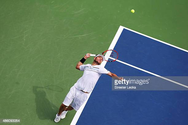 Mardy Fish of the United States serves against Marco Cecchinato of Italy during his Men's Singles First Round match on Day One of the 2015 US Open at...