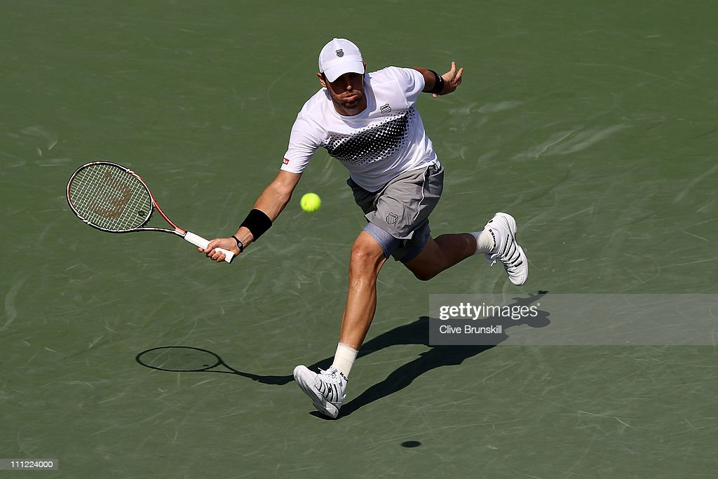 <a gi-track='captionPersonalityLinkClicked' href=/galleries/search?phrase=Mardy+Fish&family=editorial&specificpeople=206218 ng-click='$event.stopPropagation()'>Mardy Fish</a> stretches for a return against David Ferrer of Spain during the Sony Ericsson Open at Crandon Park Tennis Center on March 30, 2011 in Key Biscayne, Florida.