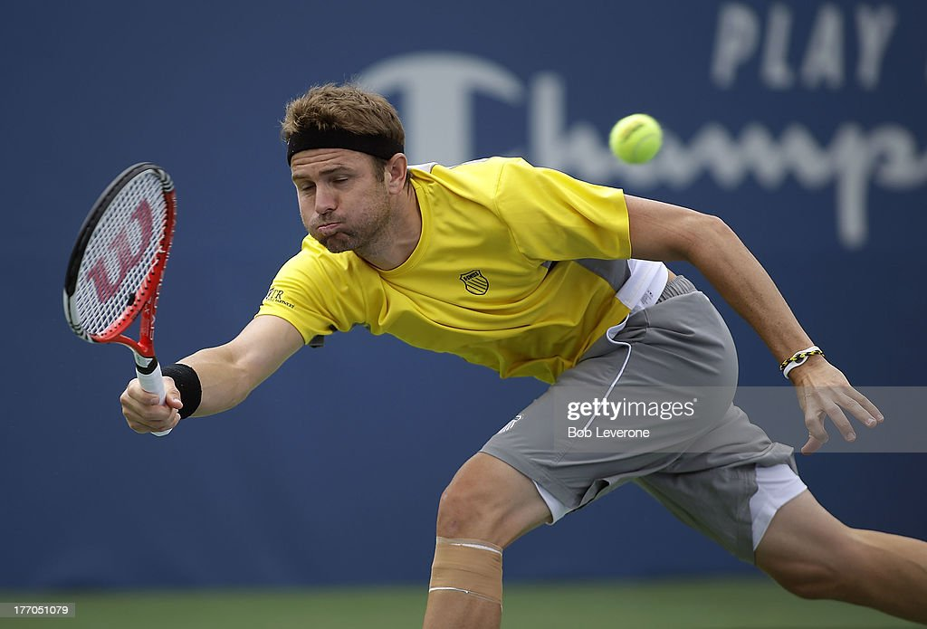 Mardy Fish stretches to return a shot against Jarkko Nieminen of Finland on August 20, 2013 in Winston Salem, North Carolina.