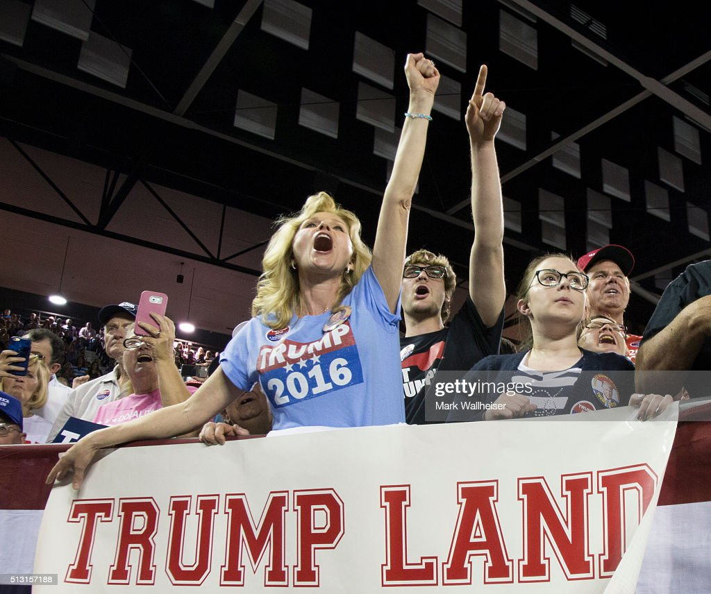 Maree Miller of Cairo Ga reacts to Republican presidential candidate Donald Trump as he speaks to supporters during a rally at Valdosta State...