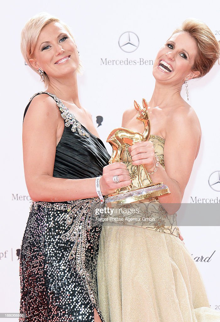 Mareille Hoeppner and Kamilla Senjo pose with the people choice Bambi at Stage Theater on November 14, 2013 in Berlin, Germany.