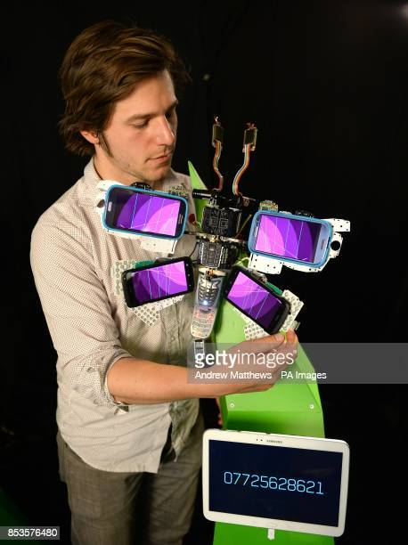 Marek Bereza cofounder of Is It Good makes some adjustments to one of the Digital butterflies made out of smartphone components which were...