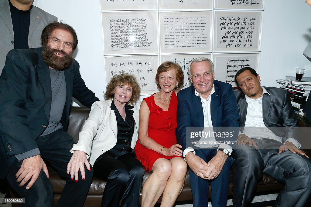 Marek Halter with his wife Clara Halter, French Prime Minister Jean-Marc Ayrault with his wife Brigitte Ayrault and Imam of Drancy Hassen Chalghoumi attend Marek Halter's Rosh Hashanah celebration for the 5774 Jewish new year at his home on September 8, 2013 in Paris, France.