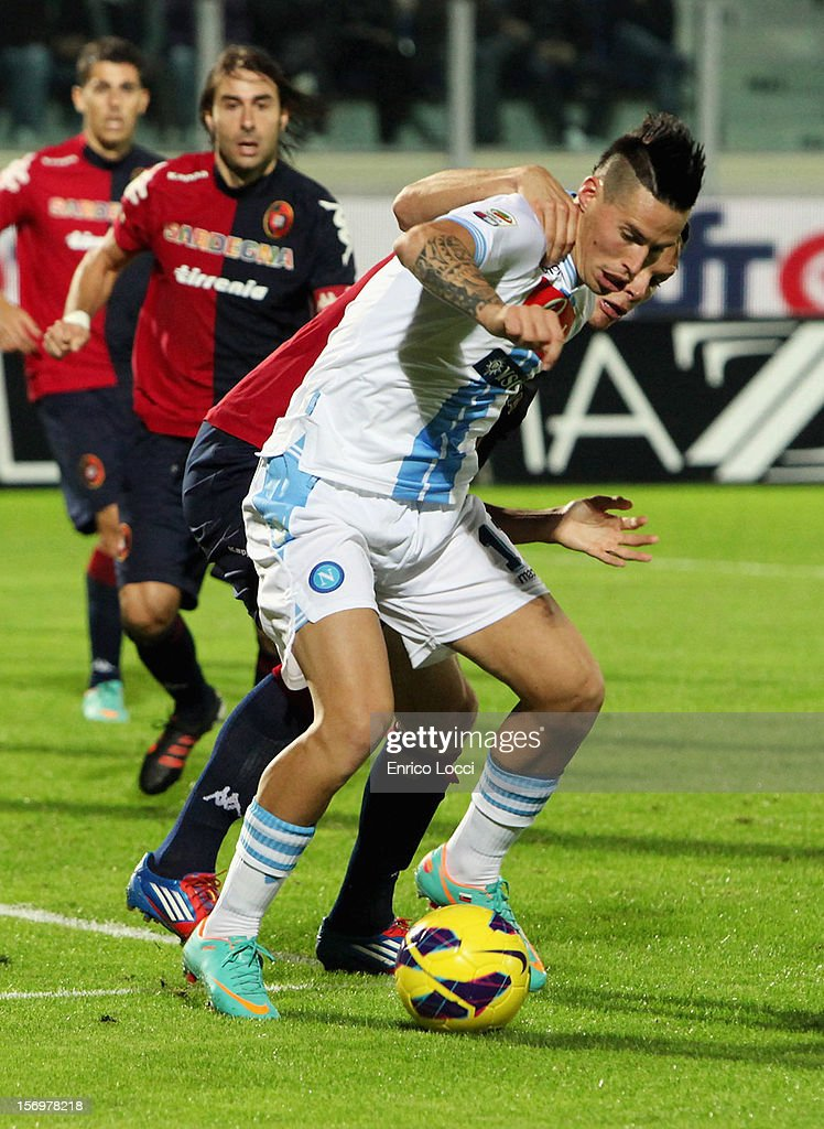 Marek Hamisk of Napoli and Ekdal Albin of Cagliari during the Serie A match between Cagliari Calcio and SSC Napoli at Stadio Sant'Elia on November 26, 2012 in Cagliari, Italy.