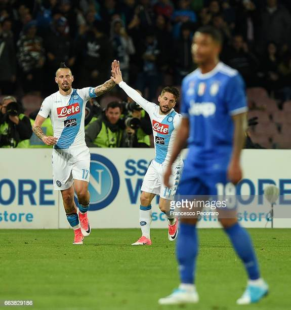 Marek Hamsik and Dries Mertens of SSC Napoli celebrate the 11 goal scored by Marek Hamsik beside the disappointment of Mario Lemina player of...