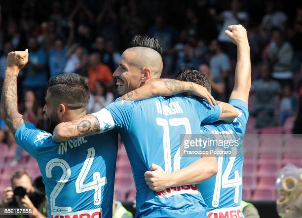 Marek Hamsik Lorenzo Insigne and Dries Mertens of SSC Napoli celebrate the 10 goal scored by Marek Hamsik during the Serie A match between SSC Napoli...
