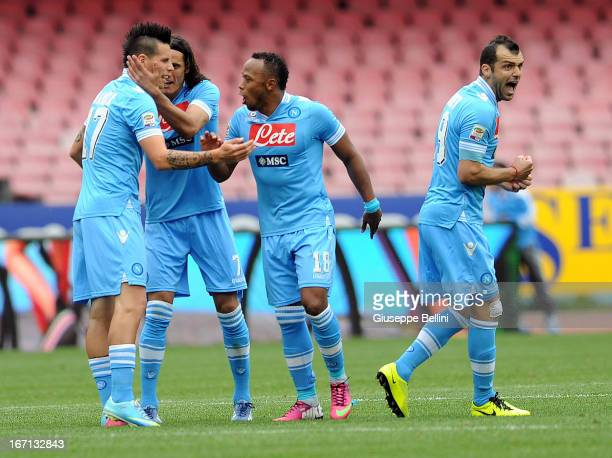 Marek Hamsik of Napoli celebrates with teammates after scoring goal 11 during the Serie A match between SSC Napoli and Cagliari Calcio at Stadio San...