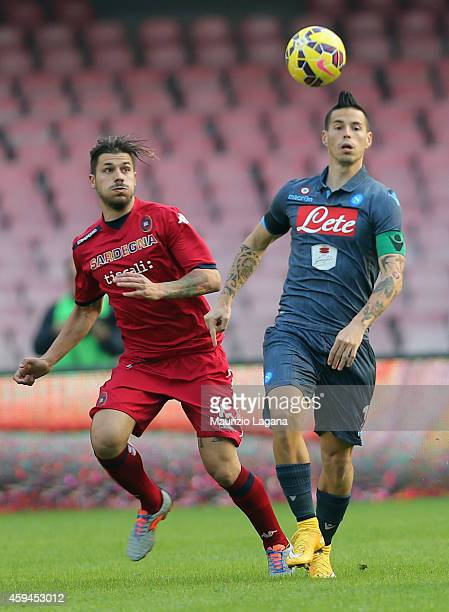 Marek Hamsik of Napoli competes for the ball with Andrea Dessena of Cagliari during the Serie A match between SSC Napoli and Cagliari Calcio at...