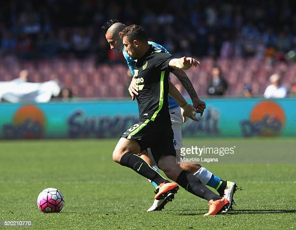 Marek Hamsik of Napoli competes for the ball with Eros Pisano of Verona during the Serie A match between SSC Napoli and Hellas Verona FC at Stadio...