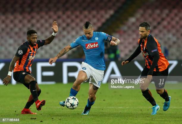 Marek Hamsik of Napoli competes for the ball with Fred and Marlos of Shakhtar Donetsk during the UEFA Champions League group F match between SSC...