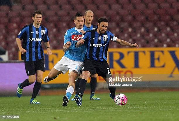 Marek Hamsik of Napoli competes for the ball with Luca Cigarini of Atalanta during the Serie A match between SSC Napoli and Atalanta BC at Stadio San...
