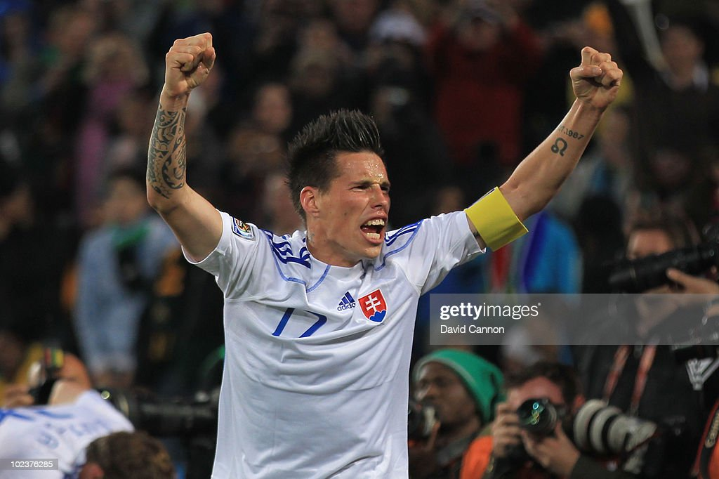 Marek Hamsik of Slovakia celebrates his team mate Robert Vittek scoring their side's second goal during the 2010 FIFA World Cup South Africa Group F...
