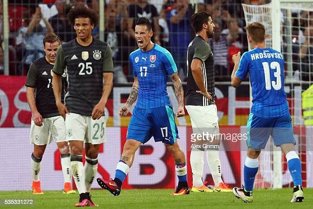 Marek Hamsik of Slovakia celebrates his team's first goal during the international friendly match between Germany and Slovakia at WWKArena on May 29...