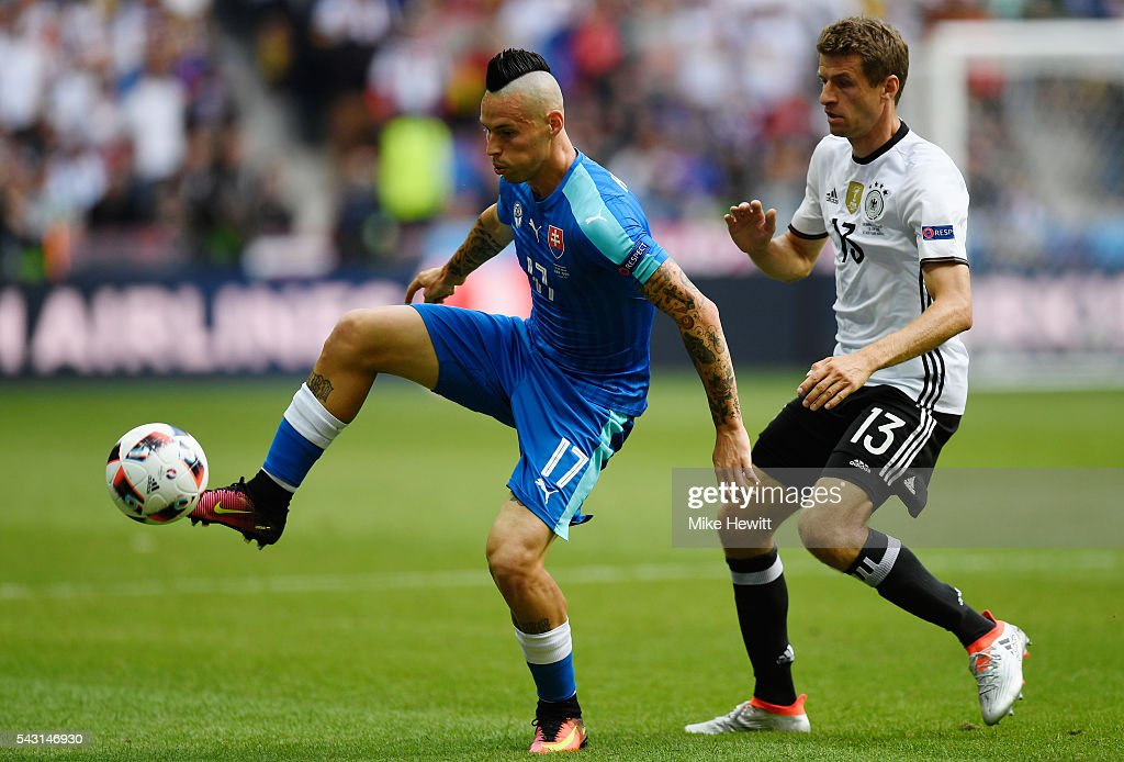 Marek Hamsik of Slovakia controls the ball under pressure of Thomas Mueller of Germany during the UEFA EURO 2016 round of 16 match between Germany and Slovakia at Stade Pierre-Mauroy on June 26, 2016 in Lille, France.
