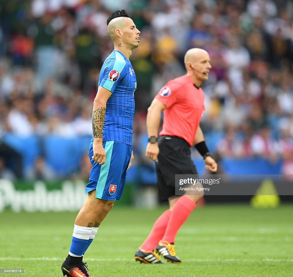 Marek Hamsik (L) of Slovakia in action during the UEFA Euro 2016 round of 16 football match between Germany and Slovakia at Stade Pierre Mauroy in Lille, France on June 26, 2016.