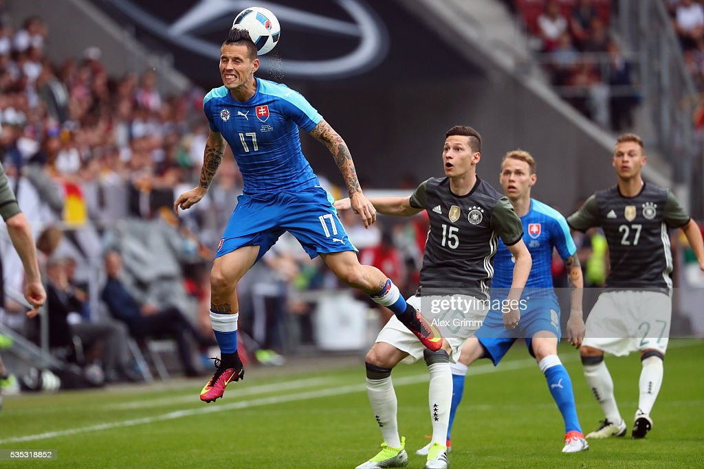 Marek Hamsik (front) of Slovakia is challenged by <a gi-track='captionPersonalityLinkClicked' href=/galleries/search?phrase=Julian+Draxler&family=editorial&specificpeople=7184479 ng-click='$event.stopPropagation()'>Julian Draxler</a> of Germany during the international friendly match between Germany and Slovakia at WWK-Arena on May 29, 2016 in Augsburg, Germany.