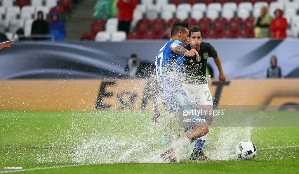 Marek Hamsik of Slovakia is challenged by Sebastian Rudy of Germany during the international friendly match between Germany and Slovakia at WWK-Arena on May 29, 2016 in Augsburg, Germany.
