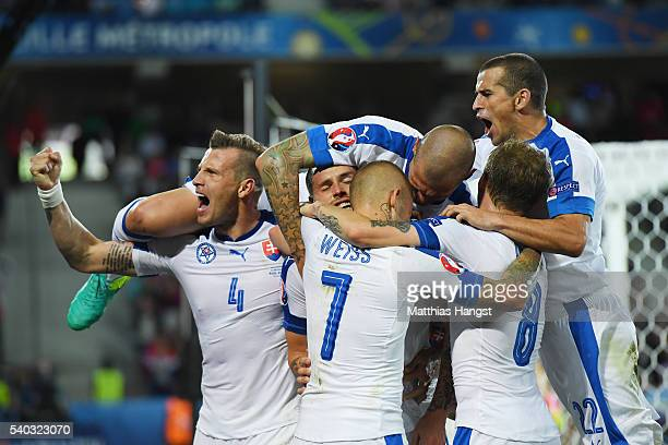 Marek Hamsik of Slovakia is mobbed by team mates after he scored his sides second goal during the UEFA EURO 2016 Group B match between Russia and...