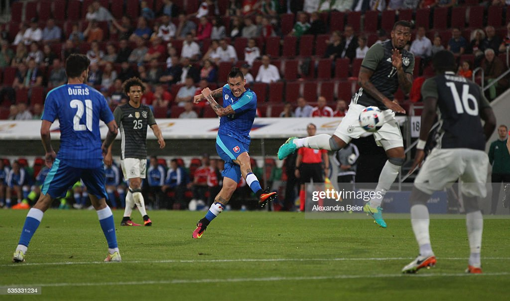 Marek Hamsik (C) of Slovakia scores his first goal during the international friendly football match between Germany and Slovakia at WWK-Arena on May 29, 2016 in Augsburg, Germany.