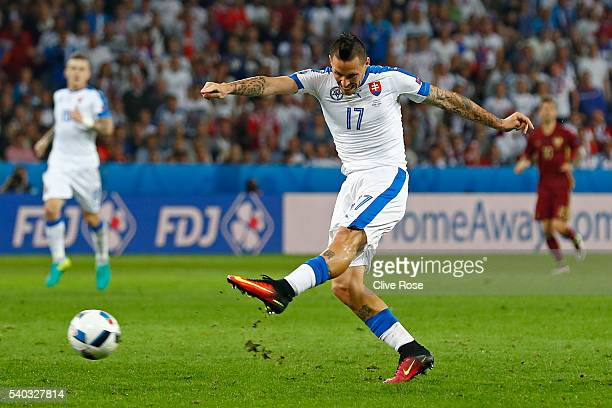 Marek Hamsik of Slovakia takes a shot on goal during the UEFA EURO 2016 Group B match between Russia and Slovakia at Stade PierreMauroy on June 15...