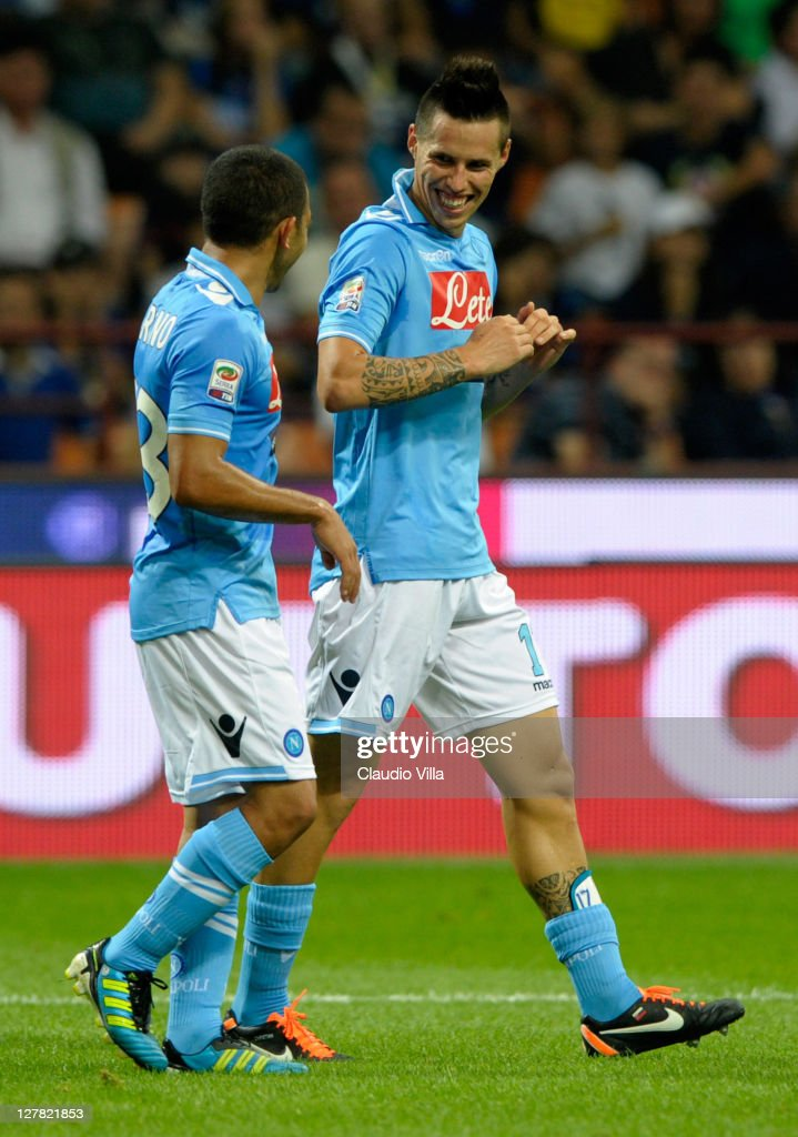 Marek Hamsik (R) of SSC Napoli celebrates after scoring his team's third goal during the Serie A match between FC Internazionale Milano and SSC Napoli at Stadio Giuseppe Meazza on October 1, 2011 in Milan, Italy.