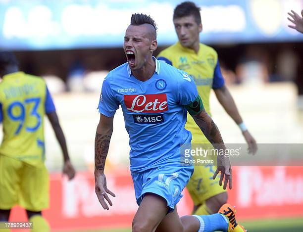 Marek Hamsik of SSC Napoli celebrates after scoring the opening goal of the Serie A match between AC Chievo Verona and SSC Napoli at Stadio...