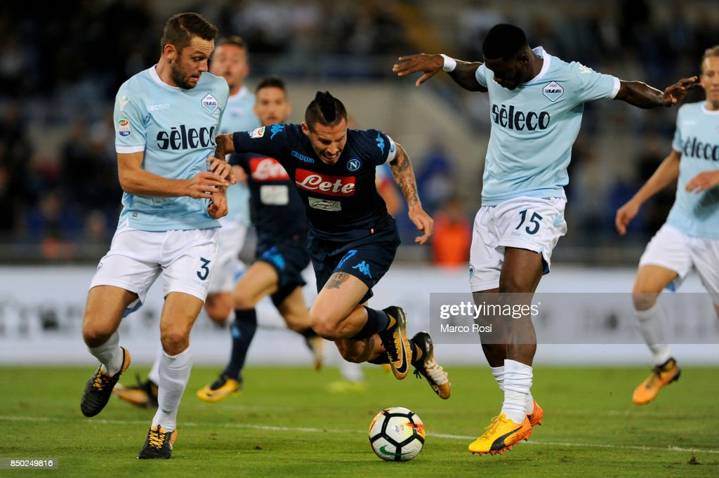 Marek Hamsik of SSC Napoli compete for the ball with Stefan De Vrij and Quissanga Bastos of SS Lazio during the Serie A match between SS Lazio and SSC Napoli at Stadio Olimpico on September 20, 2017 in Rome, Italy.