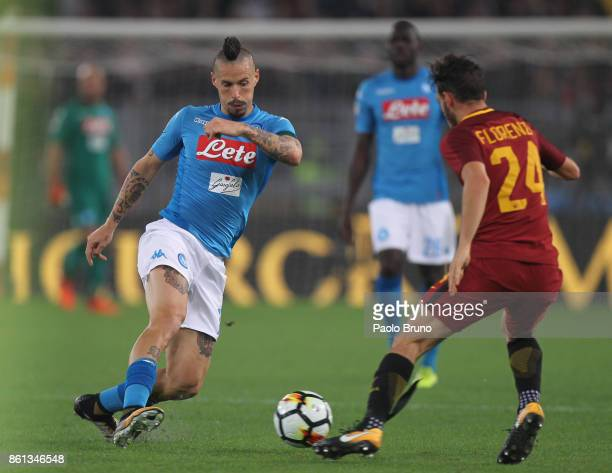 Marek Hamsik of SSC Napoli competes for the ball with Alessandro Florenzi of AS Roma during the Serie A match between AS Roma and SSC Napoli at...