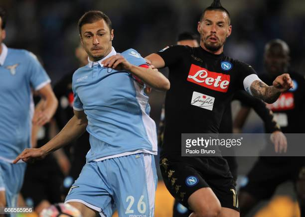 Marek Hamsik of SSC Napoli competes for the ball with Stefan Radu of SS Lazio during the Serie A match between SS Lazio and SSC Napoli at Stadio...