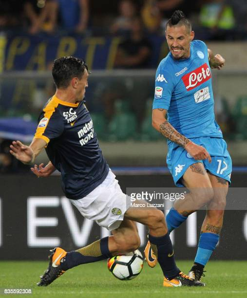 Marek Hamsik of SSC Napoli is challenged by Alex Ferrari of Hellas Verona during the Serie A match between Hellas Verona and SSC Napoli at Stadio...