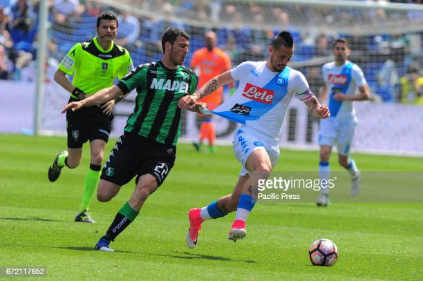 Marek Hamsik SSCNapoli's midfielder and national team of Slovacchia and Luca Mazzitelli Sassuolo's midfielder fight for the ball during the serie A...