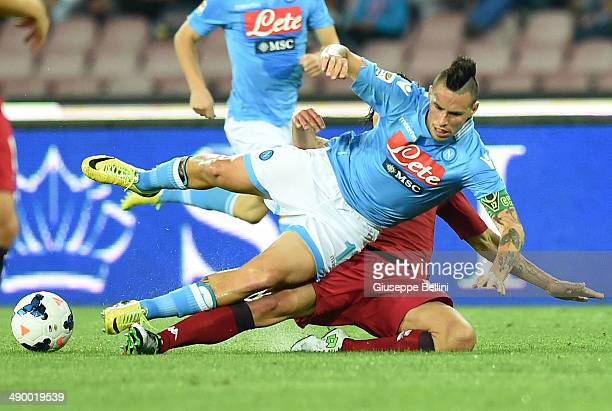 Marek Hmsik of Napoli and Daniele Dessena of Cagliari in action during the Serie A match between SSC Napoli and Cagliari Calcio at Stadio San Paolo...