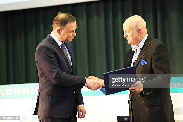 Marek Krawczyk the Rector of the Medical University of Warsaw hands Polish President Andrzej Duda and gift during the 50th anniversary symposium of...