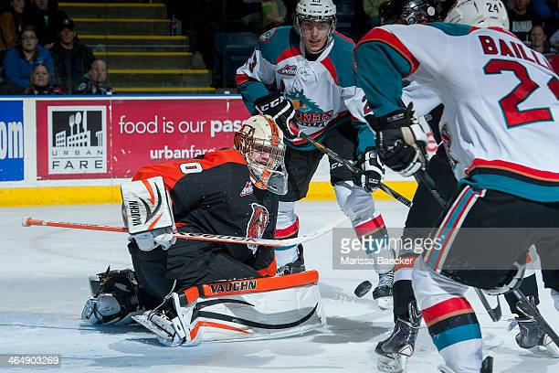 Marek Langhamer of the Medicine Hat Tigers defends the net and makes a save against the Kelowna Rockets on January 24 2014 at Prospera Place in...