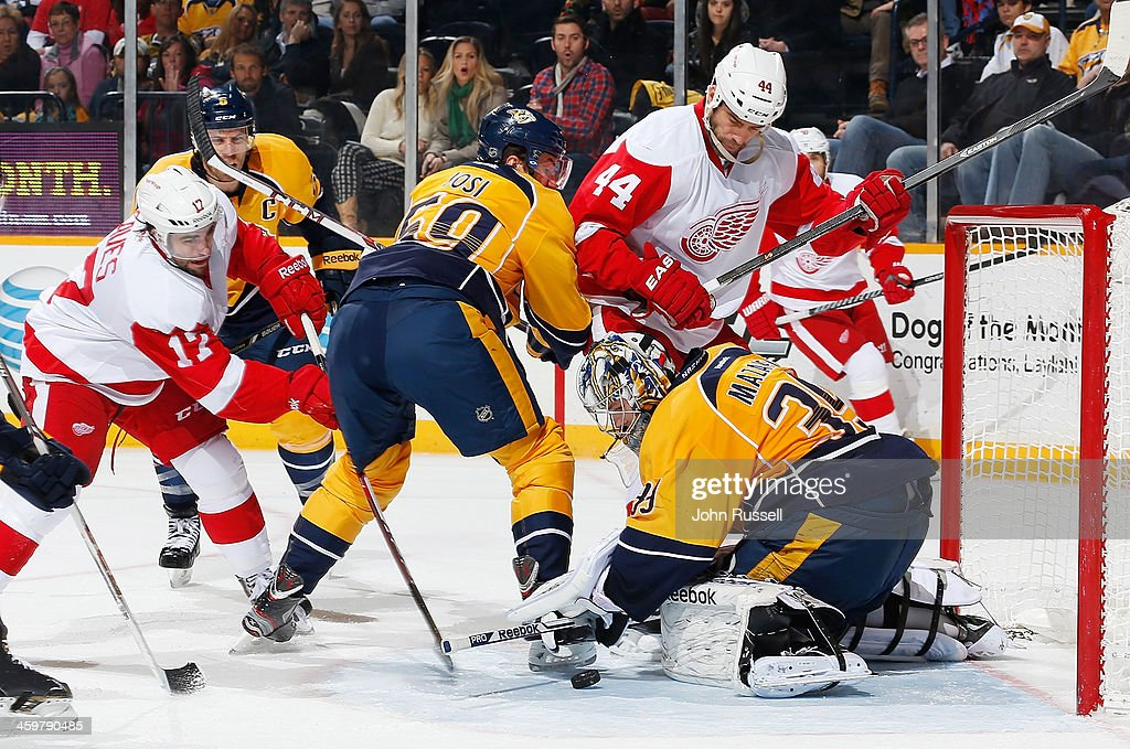 Marek Mazanec #39 of the Nashville Predators makes the save against <a gi-track='captionPersonalityLinkClicked' href=/galleries/search?phrase=Patrick+Eaves&family=editorial&specificpeople=616319 ng-click='$event.stopPropagation()'>Patrick Eaves</a> #17 of the Detroit Red Wings at Bridgestone Arena on December 30, 2013 in Nashville, Tennessee.