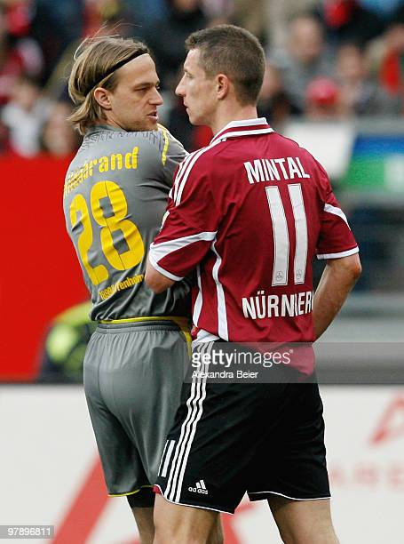 Marek Mintal of Nuernberg discusses with goalkeeper Timo Hildebrand of Hoffenheim during the Bundesliga match between 1 FC Nuernberg and 1899...