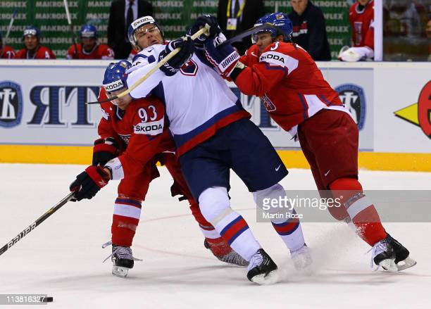 Marek Zidlicky of Czech Republic hits Jozef Stumpel of Slovakia with the stick during the IIHF World Championship qualification match between Czech...