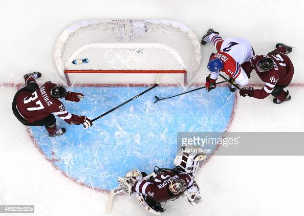 Marek Zidlicky of Czech Republic scores against Martins Karsums and Edgars Masalskis of Latvia in the second period during the Men's Ice Hockey...