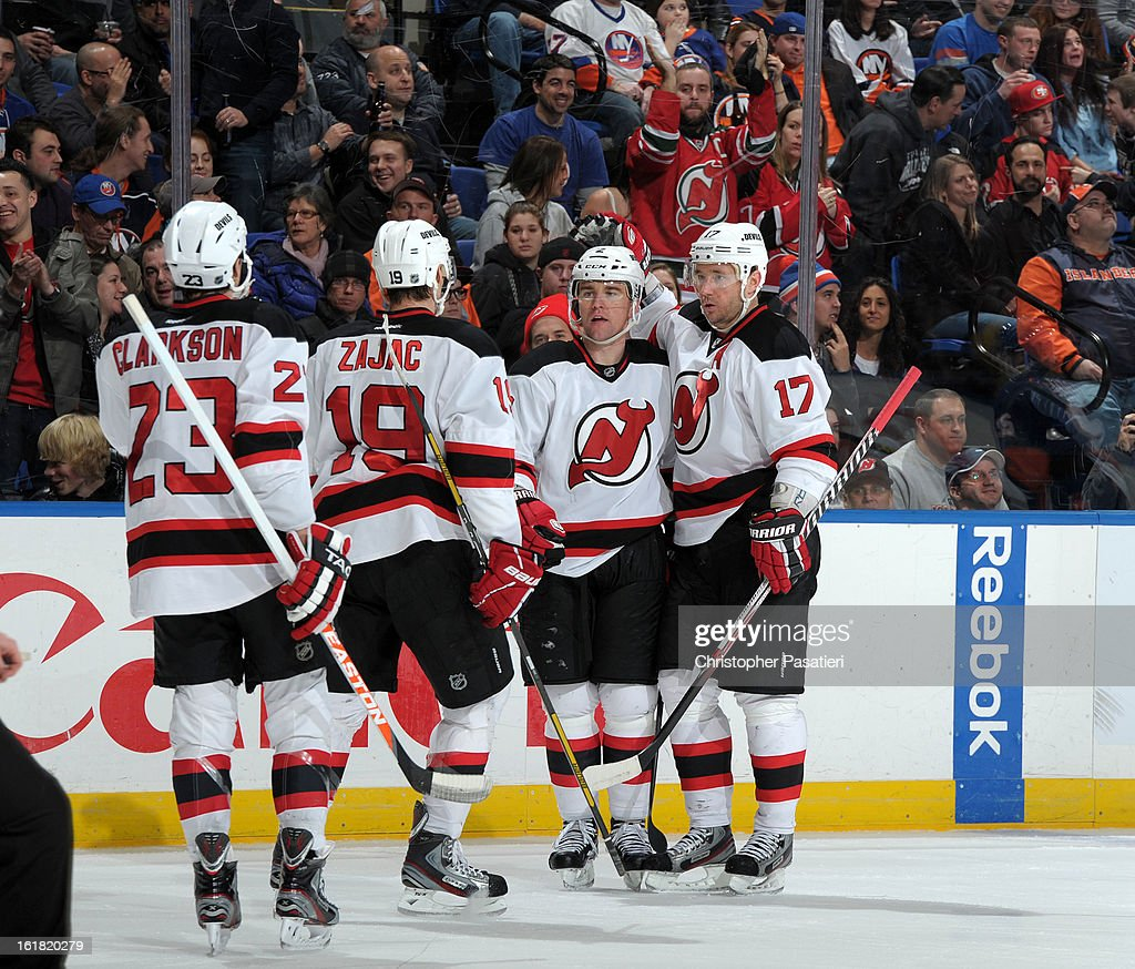 Marek Zidlicky #2 of the New Jersey Devils is congratulated by Ilya Kovalchuk #1, Steve Bernier #18, and David Clarkson #23 after scoring a goal during the game against the New York Islanders on February 16, 2013 at Nassau Veterans Memorial Coliseum in Uniondale, New York.