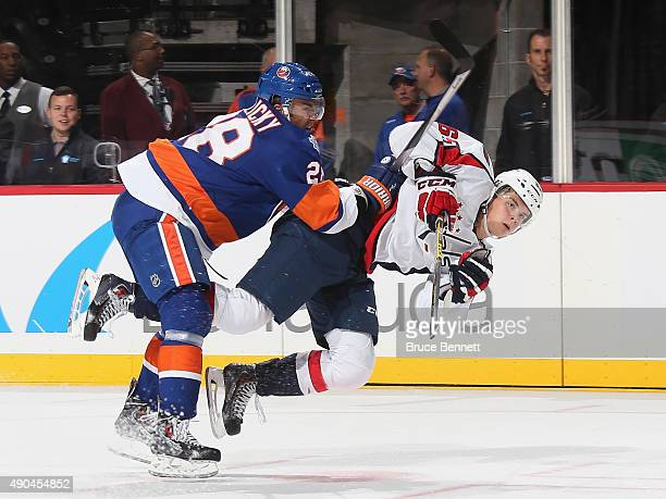 Marek Zidlicky#28 of the New York Islanders checks Andre Burakovsky of the Washington Capitals during the first period at the Barclays Center on...