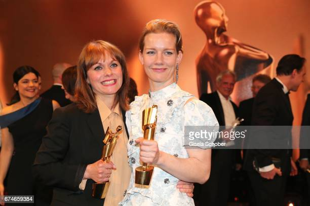 Maren Ade and Sandra Hueller pose with their awards after the Lola German Film Award show at Messe Berlin on April 28 2017 in Berlin Germany