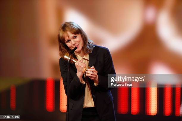 Maren Ade speaks on stage after receiving the awards for Best Screenplay and Best Director for Toni Erdmann at the Lola German Film Award show at...