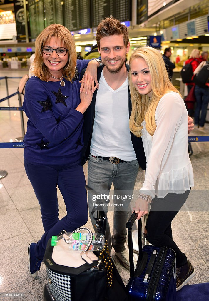 Maren Gilzer Joern Schloenvoigt and Anelina Heger pose before the flight to Australia as a participants in the 2015 RTLTVShow 'Dschungelcamp Ich bin...