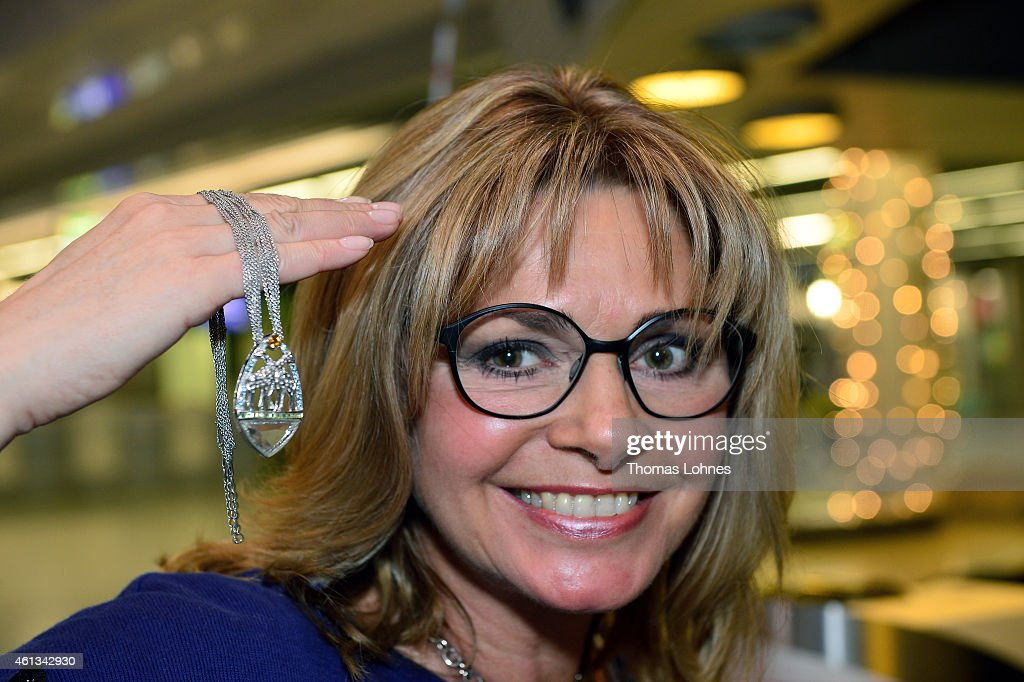Maren Gilzer poses with her jewelry before the flight to Australia as a participant in the 2015 RTLTVShow 'Dschungelcamp Ich bin ein Star Holt mich...