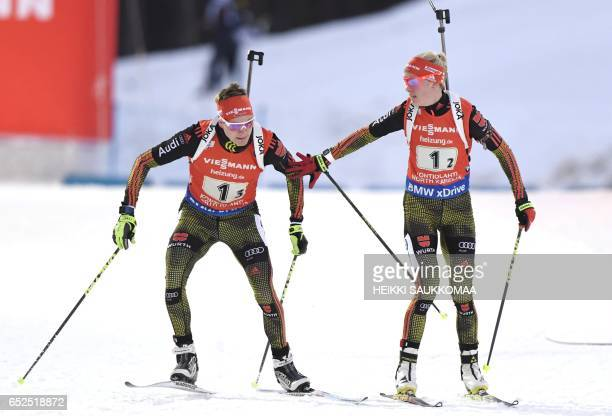 Maren Hammerschmidt and Benedikt Doll of Germany are seen during an exchange during the 2x6 2x75 km mixed relay competition at the IBU Biathlon World...