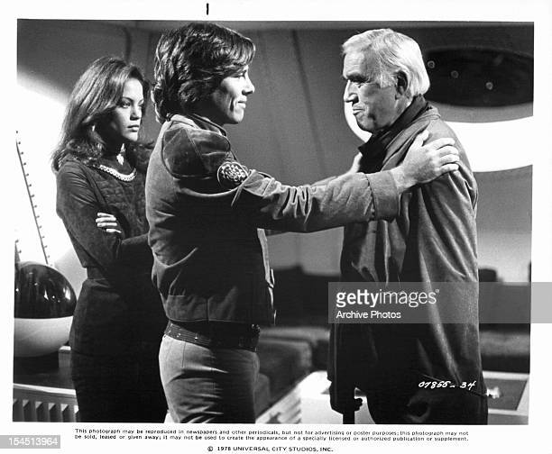 Maren Jensen and Richard Hatch reassure their father Lorne Greene in a scene from the television series 'Battlestar Galactica' 1978