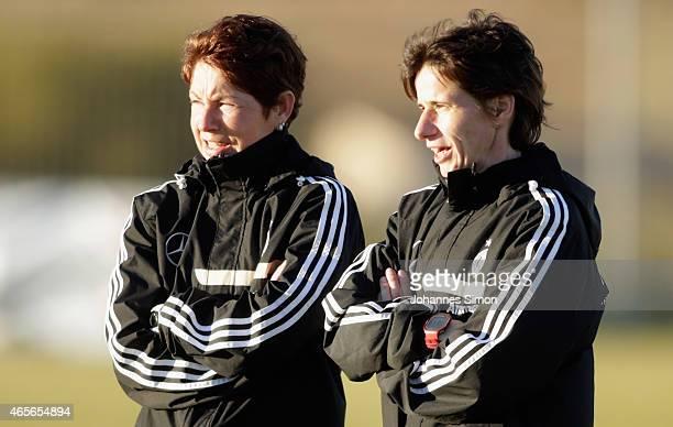 Maren Meinert head coach and Bettina Wiegmann assistant coach of Germany look on ahead of the women's U19 international friendly match between...