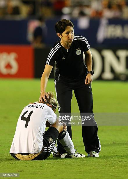 Maren Meinert head coach of Germany comforts Jennifer Cramer after losing the FIFA U20 Women's World Cup Japan 2012 Final match between USA and...