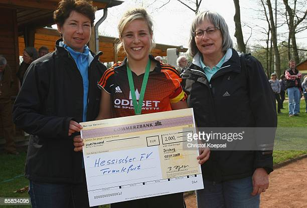 Maren Meinert head of competition hands out a cheque for the third place to Svenja Huth of Hessen and Baerbel Petzold member of the board of women�s...