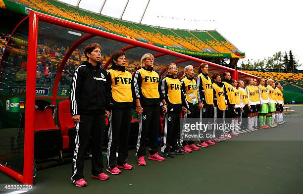Maren Meinert of Germany stands alongside her team as they sing the national anthem prior to their match against China PR at Commonwealth Stadium on...